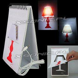 Lampka biurkowa ukryta w ciekawym notesie jak kalendarz biurkowy